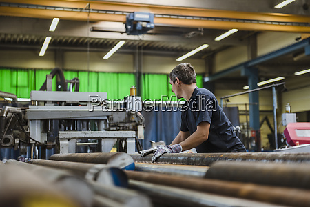 man working with metal bars in