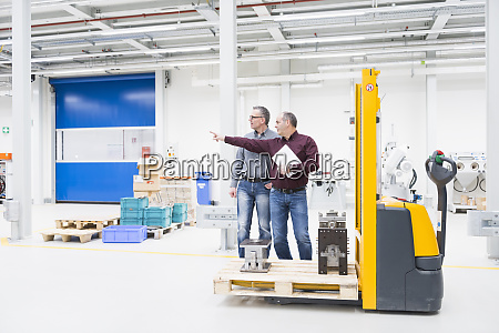 two businessmen having a discussion in