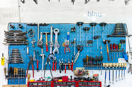 bicycle shop wall with various tools