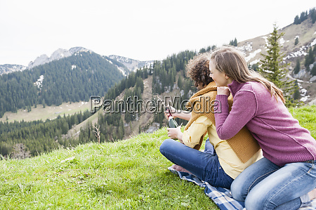 happy woman leaning on man opening