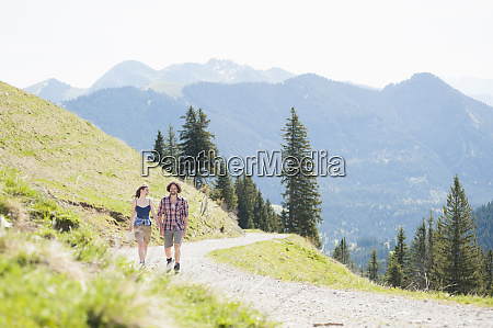 hiking couple on hiking trail in