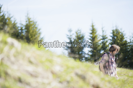 hiking man on meadow wallberg bavaria