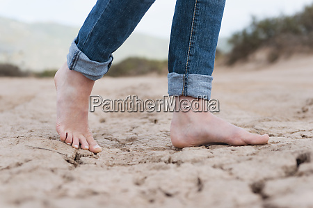 womans feet on dry soil sardinia