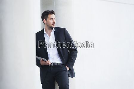 businessman wearing suit and holding digital