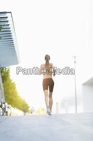 female jogger on street in the