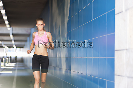 female jogger in tunnel