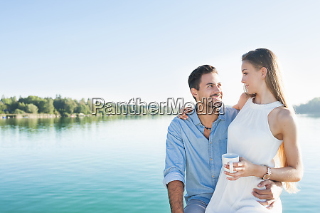 young couple relaxing in front of