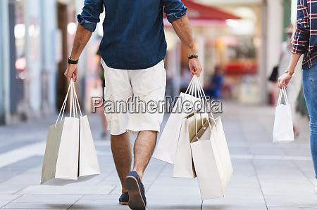 crop view of man carrying shopping