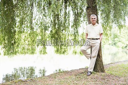 portrait of smiling senior man leaning