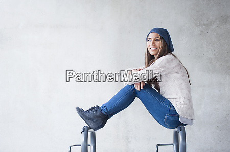 thoughtful woman sitting on metallic rails