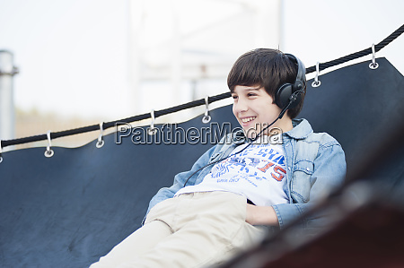 happy boy looking away while listening