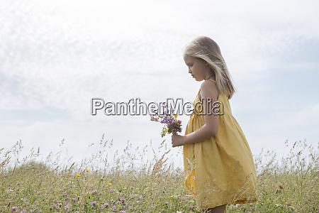 blond little girl wearing yellow dress
