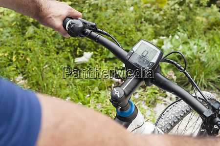 senior man with e bike cyclometer