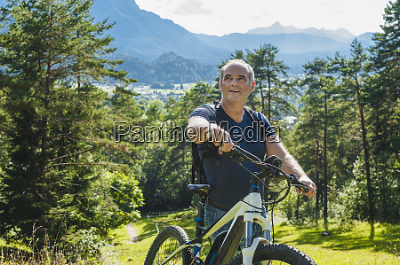 senior man with e bike
