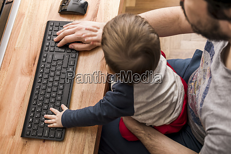 father working from home with his