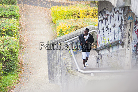 young man jogging on steps