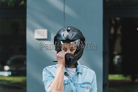 woman with black motorcycle helmet
