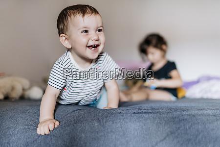 portrait of happy baby girl crawling