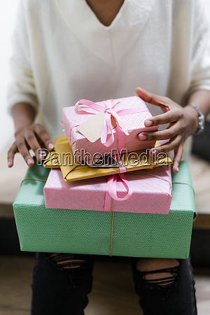young woman with stack of wrapped