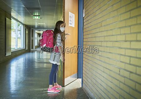 girl wearing mask in school opening