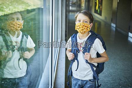boy wearing mask in school mirrored