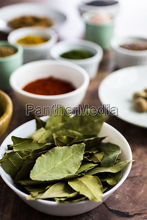 bowl of bay leaves and spices