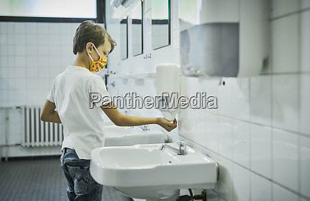 boy wearing mask on school toilet
