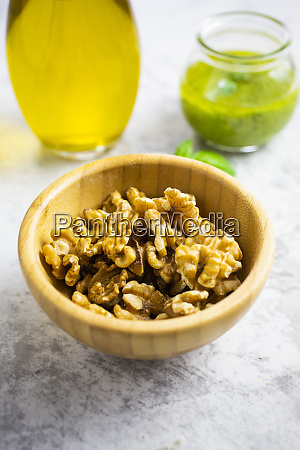 bowl of walnuts pesto and olive