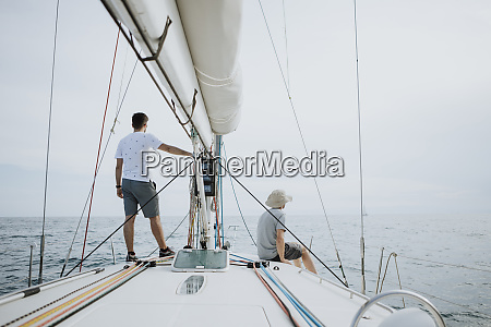 friends looking at view while sailing