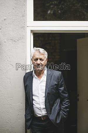 senior businessman leaning in open office