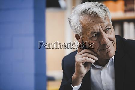 senior businessman looking confident portrait