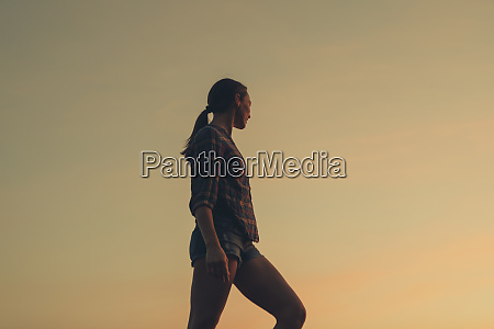woman standing on one leg at