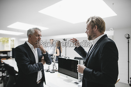 two businessmen discussing on a meeting
