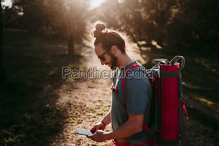 bearded man with smartphone on a
