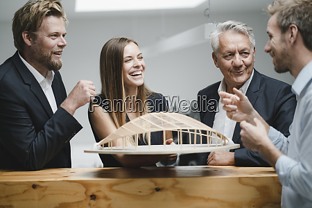 successful business people looking at architectural