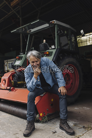 smiling senior man on a farm
