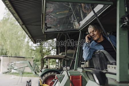 senior man on the phone on