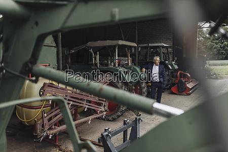 senior businessman on a farm with