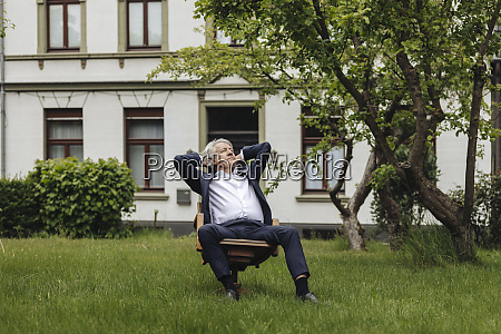 relaxed senior businessman sitting on a