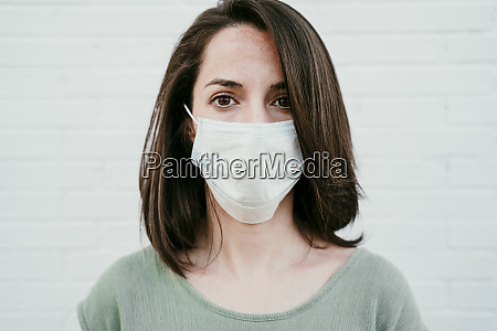 portrait of woman wearing protective mask