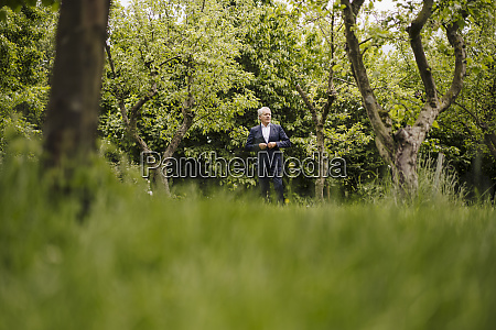 senior businessman in a rural garden
