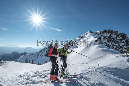 friends skiing on snowcapped mountain against