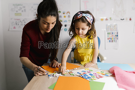 mother and daughter doing crafts at