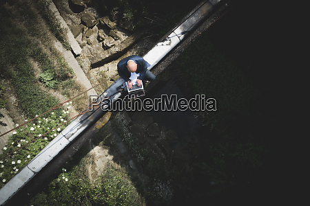 drone shot of bald businessman using