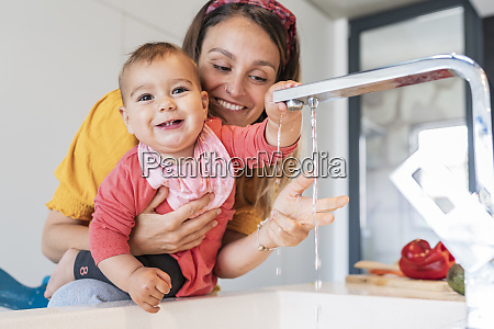 smiling mother and cute baby girl