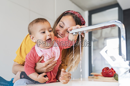close up of smiling mother holding