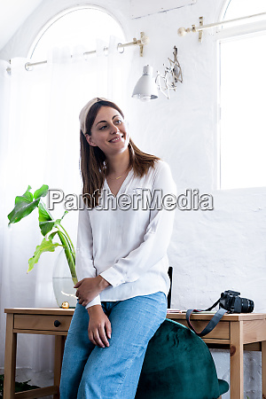 smiling woman looking away while leaning