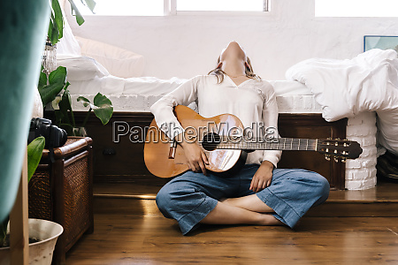 woman with guitar sitting on the
