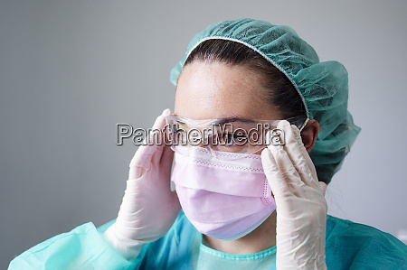close up of nurse wearing protective