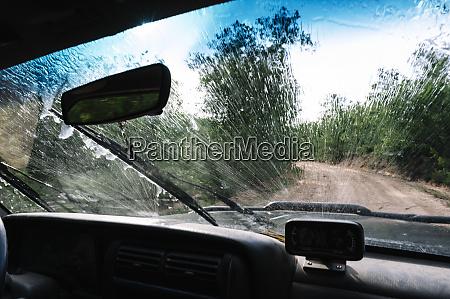 splashing water on vehicle windshield during